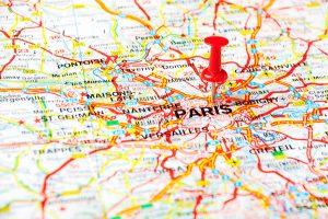 Red push pin pointing at Paris France