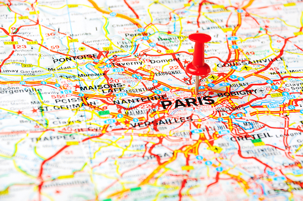 Red push pin pointing at Paris France