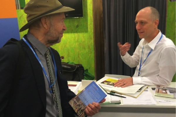 Dr. James Hansen speaking with Dr. Michael Gillenwater at GHGMI exhibit. Photo credit: J. Niles.
